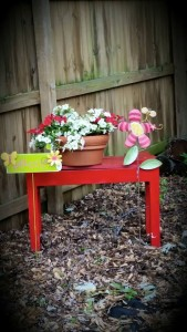 Found this bench in the basement, painted it red and put a pot on it!